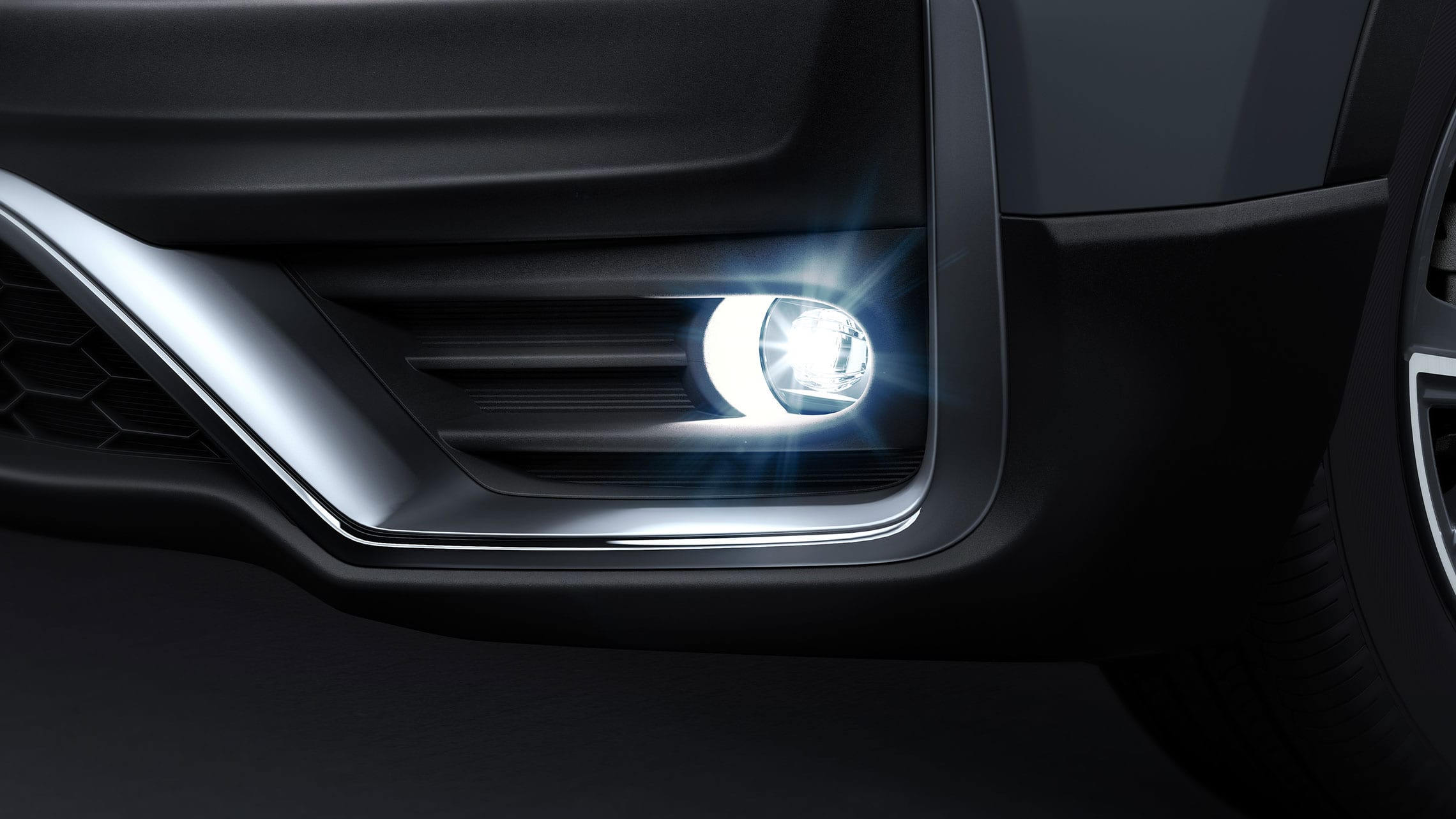Driver-side fog light detail shot on the 2020 Honda CR-V Touring in Sonic Gray Pearl.