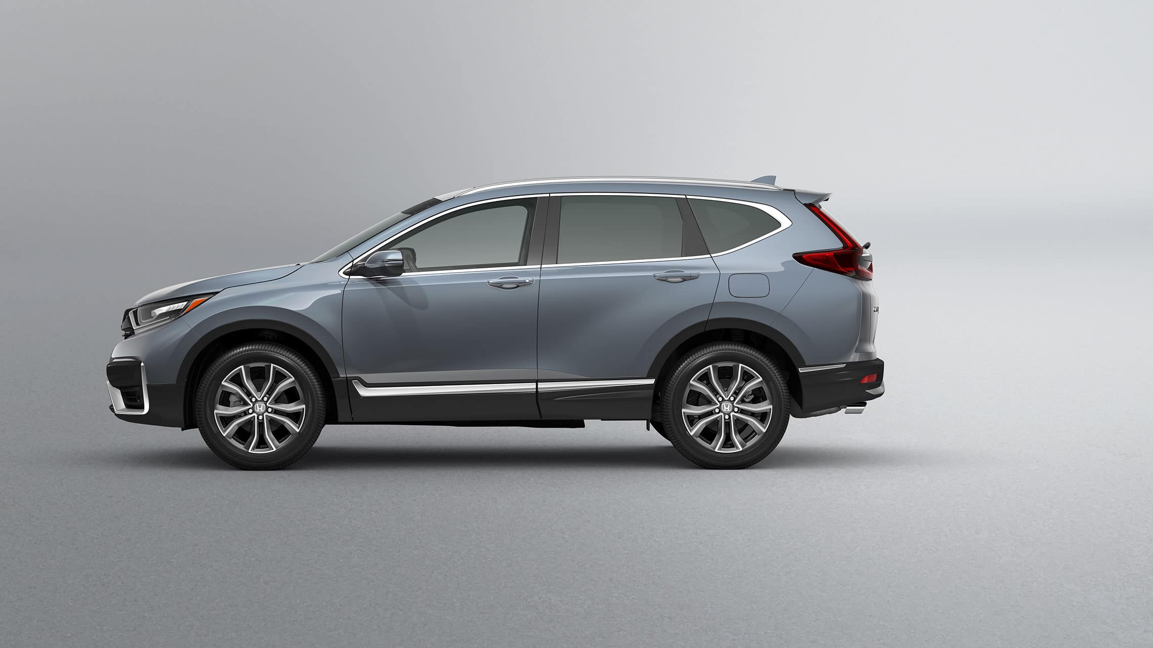 Driver-side profile view of 2020 Honda CR-V Touring in Sonic Gray Pearl.
