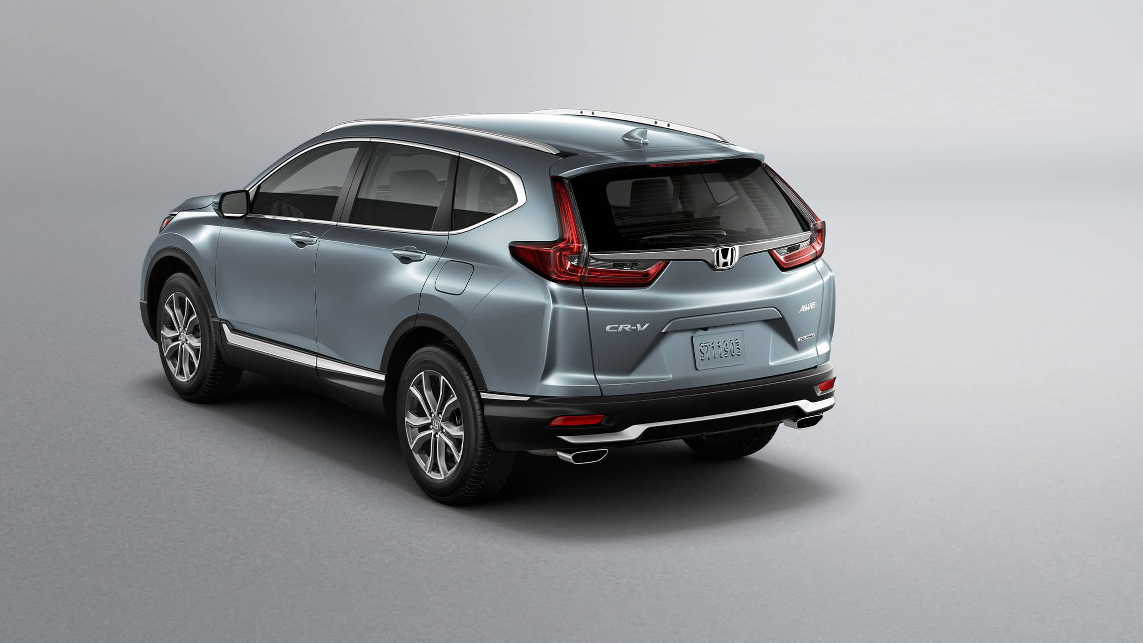 Rear 3/4 driver-side view of 2020 Honda CR-V Touring in Sonic Gray Pearl showing LED taillights.