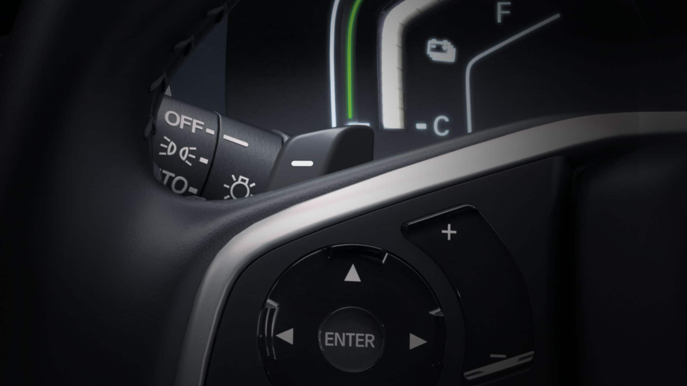 Detail view of the 2021 CR-V Hybrid Touring steering wheel with deceleration selectors.